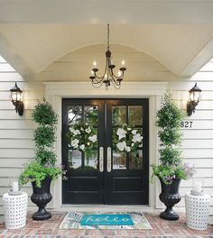 Farmhouse front door ideas that will give your home a whole new look. Discover front door ideas that are sure to give your visitors a stylish welcome. Double Front Entry Doors, Front Door Porch, Front Door Entrance, House Front Door, House With Porch, Front Door Decor, Double Door Wreaths, Black Front Doors, Black Door