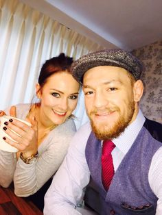 Irish fighter Conor McGregor and girlfriend Dee Devlin on Christmas day 2014 : if you love #MMA, you will love the funny & outrageous #MixedMartialArts and #UFC inspired gear at CageCult: http://cagecult.com/mma
