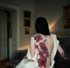 Hibiscus tattoo on back - 65 Beautiful Flower Tattoo Designs