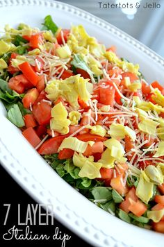 an Italian spin on 7-Layer Dip:  cannellini beans, pesto, roasted red peppers, Roma tomatoes, shredded Parmesan cheese (or mozzarella), shredded Romaine lettuce and chopped artichoke hearts
