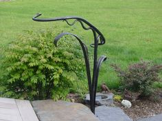 DescriptionMaker details This small hand-forged railing provides a visual accent and a transition from the deck to the garden and walkway Dimensions high by long by wide Sculptural Hand Railing Porch Handrails, Outdoor Stair Railing, Front Porch Railings, Metal Handrails, Metal Stairs, Banisters, Rebar Railing, Wrought Iron Stair Railing, Hand Railing