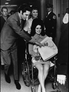 Elvis doting on Priscilla and baby Lisa Marie.  Rocks first family is made.