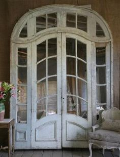 how gorgeous and inviting are these doors? I would love this to open to my bedroom onto a screened porch!
