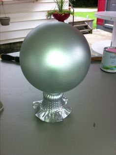 Gazing Ball made from spray painted Bowling Ball and Ceiling Fan globe for it to sit upon.