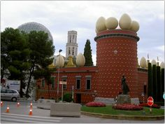 The Torre Galatea Figueras, Spain  Looking at those huge eggs on the roof line could give you a hint of what this building is. It's the Salvador Dali Museum and now it all makes sense!