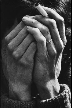 Bad Trouble over the Weekend. Dorothea Lange, 1964. Her ring and cigarette, the creases around her eyes, and the title.