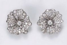 A PAIR OF DIAMOND FLORAL EARCL