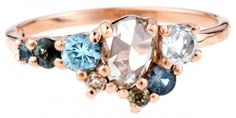 Custom Ombré Diamond and Gemstone Cluster Ring. I love the Asymetrical design!