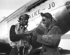 Tuskegee airman Captain Wendell O. Pruitt, one of the leading pilots of the 15th Air Force, always makes sure to leave his valuable ring with his crew chief Staff Sargent Samuel Jacobs, prior to going on a mission in his P-51C Mustang named Alice-Jo, Ramitelli Airfield, Italy, November 1944.