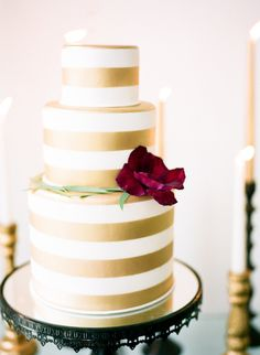 #gold, #cake, #stipes Photography: Sarah Beth Photography - www.sbethphoto.com Read More: http://www.stylemepretty.com/2015/04/28/modern-melrose-mansion-wedding-inspiration/