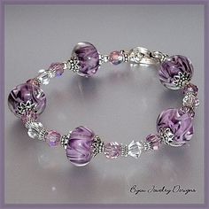 This is beautiful! Wisteria~ Boro Lampwork, Swarovski and Sterling Bracelet from bijoujewelrydesigns on Ruby Lane