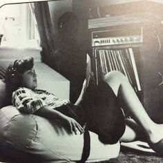A young woman listening to music and smoking a cigarette in her room. With a shift in culture during the 70s, students began to spend more time in their rooms, leading to many of the clashes with administrators during the decade. 1975 #MiamiUniversity #MUArchives #OxfordOH #Recensio