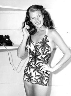 Rita Hayworth talks with a West Point cadet who won the phone call as first prize in a quiz contest, 1940s