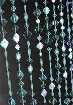 18.00 SALE PRICE! Carry a blue color scheme throughout your event by incorporating these Iridescent Acrylic Crystal Curtains in aqua. Hanging on a plastic ro...
