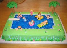 Swimming Pool Cake - I made this for my niece's pool party birthday.  She is the one on the yellow seal.  All the little characters had such personality.  Cake covered in buttercream, fondant figures, piping gel pool, gumpaste diving board and royal icing palm trees.  I think that covers all cake decorating mediums : )