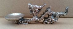 Check out this item in my Etsy shop https://www.etsy.com/uk/listing/477298771/vintage-white-metal-chinese-dragon