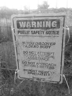 If you discover a dead body...???? REALLY? There needs to be a sign for this---I would be out of there and calling 911--approach it---ummm--NOOOOO
