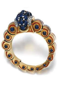 Sapphire, diamond, enamel and gold bangle, Jacques Lacloche, circa 1935 The front set with carved sapphires of leaf motifs, highlighted with circular-cut diamonds, the highly articulated band composed of gold segments, the sides accented with red enamel and carved sapphires, inner circumference approximately 140mm, expandable, signed J. Lacloche, French maker's mark.