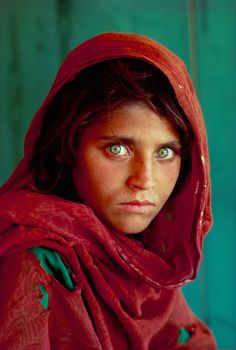 Famous photograph by Steve McCurry, a photographer for National Geographic.  This anonymous Afghan girl was on the cover of the magazine in 1984.  It has become an iconic image.  She has beautiful green eyes, but such a sober look for one so young.