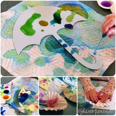 Rain Drops & Umbrellas kid craft from Share and Remember. used coffee filters to blot up extra watercolors and then cut them into raindrops when they dried.