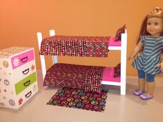 """DIY 18"""" Doll Furniture:  Bunk bed can be made from 8"""" or 10"""" board. Bedposts are 1 1/8"""" by 1 1/8"""" corner guard moulding from Home Depot. Headboards are a piece of craft wood. Our dolls live in a converted cabinet so space is limited. You can make the beds taller if space allows. Mattresses cut from 1"""" foam and covered. Chest of drawers was an unfinished craft store find.  Rug is a piece felt """"fringed"""" with scissors."""