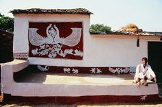 Front wall of a Meena house painted with Mandana of moradi.