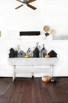 Create a sleepy, yet somewhat spooky DIY Halloween Vignette using birdhouses and a couple of branches. Find out more at livelaughrowe.com