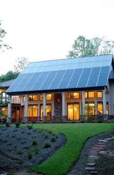 This North Carolina home gets most of its space heating from the passive solar design, but the solar thermal system (top of roof) supplies both domestic hot water and a secondary radiant floor heating system. | Photo courtesy of Jim Schmid Photography.