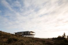 Dock House in coastal Chile by SAA rests on triangular wooden stilts - Architecture Chile, Dock House, Modern Wooden House, Boat Shed, Wooden Facade, Back Road, Shipping Container Homes, Amazing Architecture, Seaside