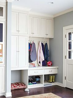 Entryway organization - stock cabinetry and coat hooks create a neat and efficient mudroom