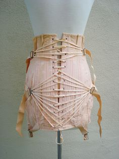 vintage 1930s Peach corset fan Pulley Lace girdle garters. $79.00, via Etsy.