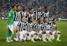 The Juventus team lines up before the match between the ALeague All...