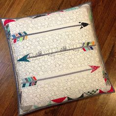 Quilted arrow pillow by Three Owls, via Flickr