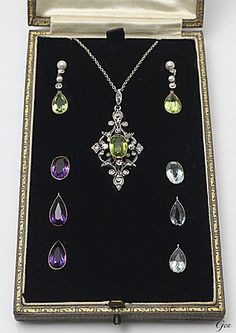Three color Stone Pendant and Earrings, United Kingdom, around 1880: Peridot, Amethyst, and Aquamarine. Old European cut diamonds, rose-cut diamond, Silver, and 18ct Gold Pendant.