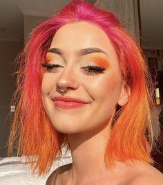 orange eye makeup ; pink & orange hair