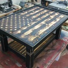 Pallet Plans Blown away by this Rustic Flag Coffee Table! Click through to see more pictures of this RYOBI Nation DIY project. - Here is a rustic coffee table that I just finished up for a lady. I framed it all out by using furring strips, used some pine tongue and groove for the bottom shelf, painted and scuffed the frame, and added a flag top. I came out really nice.