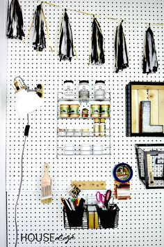 I'm always looking for quick an easy organization hacks. This pegboard is the BEST way to organize lots of smaller items in my craft room.