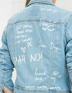 Denim jacket with text on back. Discover this and many more items in Bershka with new products every week