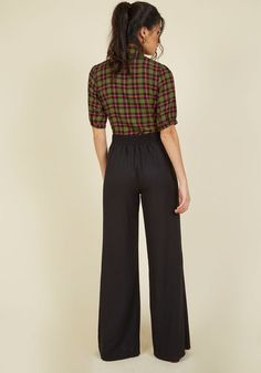 You take any opportunity to go above and beyond so today, you apply your next-level attitude to your style by wearing these wide-legged black trousers. The bronze sailorette buttons lining the pockets are your medallions of honor for forward-thinking!