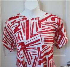 Shirt that opens at the shoulder with velcro.  Created for post surgery - shoulder, breast cancer, mastectomy and heart - Also great for breastfeeding moms.