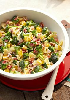 Tangy Broccoli-Pasta Salad – Broccoli florets, crumbled bacon, chopped peppers, and bow-tie pasta make this cold pasta salad recipe as colorful as it is tangy!
