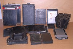 A large collection of metel cut film holders for plate cameras - Zeiss, Goerz