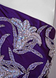 1970's Stavropoulos One-Shoulder Purple Beaded Sequin Silk Gown....tell you what...I DO NOT LIKE IT! Applique....horrible! SORRY!