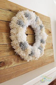 To make a beautiful Winter Yarn Pom Pom Wreath, all you need is a wreath form, yarn, hot glue gun or push pins.