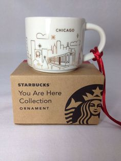 How cute is this Christmas ornament? It's a mini 2 oz. version of a Chicago Starbucks You are Here mug done in white and gold for the holidays with a jolly red interior.