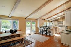 Kitchen: Open concept kitchen with vaulted ceiling and natural wood beams
