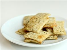 """Homemade crackers - recipe  (similar) """"Lavash Crackers""""    Makes 1 sheet pan of crackers    * 1 1/2 cups (6.75 oz) unbleached bread flour or gluten free flour blend (If you use a blend without xanthan gum, add 1 tsp xanthan or guar gum to the recipe)  * 1/2 tsp (.13 oz) salt  * 1/2 tsp (.055 oz) instant yeast  * 1 Tb (.75 oz) agave syrup or sugar  * 1 Tb (.5 oz) vegetable oil  * 1/3 to 1/2 cup + 2 Tb (3 to 4 oz) water, at room temperature"""
