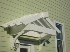Build a pergola over the laundry room door! It will mimic shape of roof and add interest (and a bit o' shade).