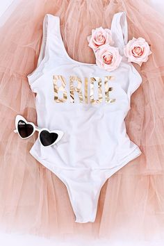Bride Swimsuits are perfect for wearing at your bachelorette party weekend and honeymoon too Printed with gold foil for a little bling makes a cute bridal shower gift too Pair them with our adorable bride sunglasses in heart shape for the ultimate gift Bachelorette Party Pictures, Bachelorette Party Sash, Bachelorette Party Planning, Bachelorette Party Shirts, Bachelorette Weekend, Cute Bridal Shower Gifts, Bridal Showers, Bacherolette Party, Gold Foil