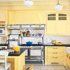 Yellow Painted Kitchens soft blue and yellow kitchens | love the butter yellow on these